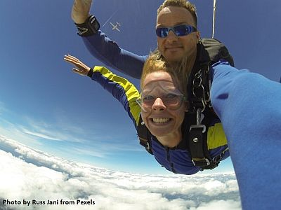 fisheye-photography-of-man-and-woman-sky-diving-739568.jpg